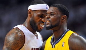 May 30, 2014; Miami, FL, USA; Miami Heat forward LeBron James (6) stands next to Indiana Pacers guard Lance Stephenson (1) in game six of the Eastern Conference Finals of the 2014 NBA Playoffs at American Airlines Arena. Mandatory Credit: Steve Mitchell-USA TODAY Sports