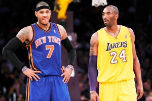 Los Angeles Lakers' Kobe Bryant (R) talks with New York Knicks' Carmelo Anthony (L) during the first half of their NBA basketball game in Los Angeles December 29, 2011. REUTERS/Danny Moloshok (UNITED STATES - Tags: SPORT BASKETBALL)